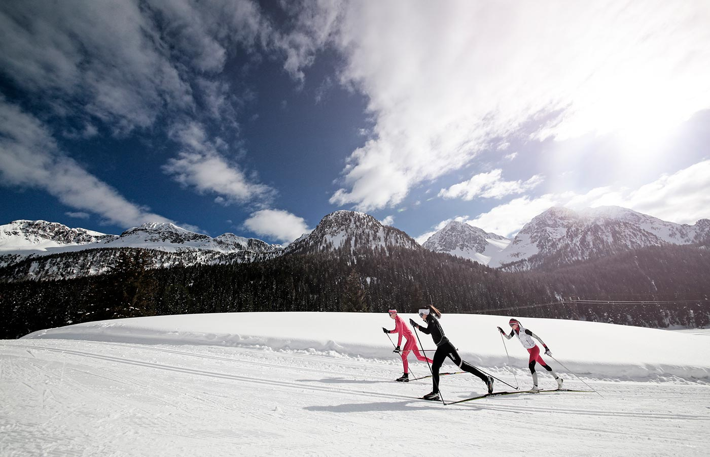 Skiers spend a day moena in winter